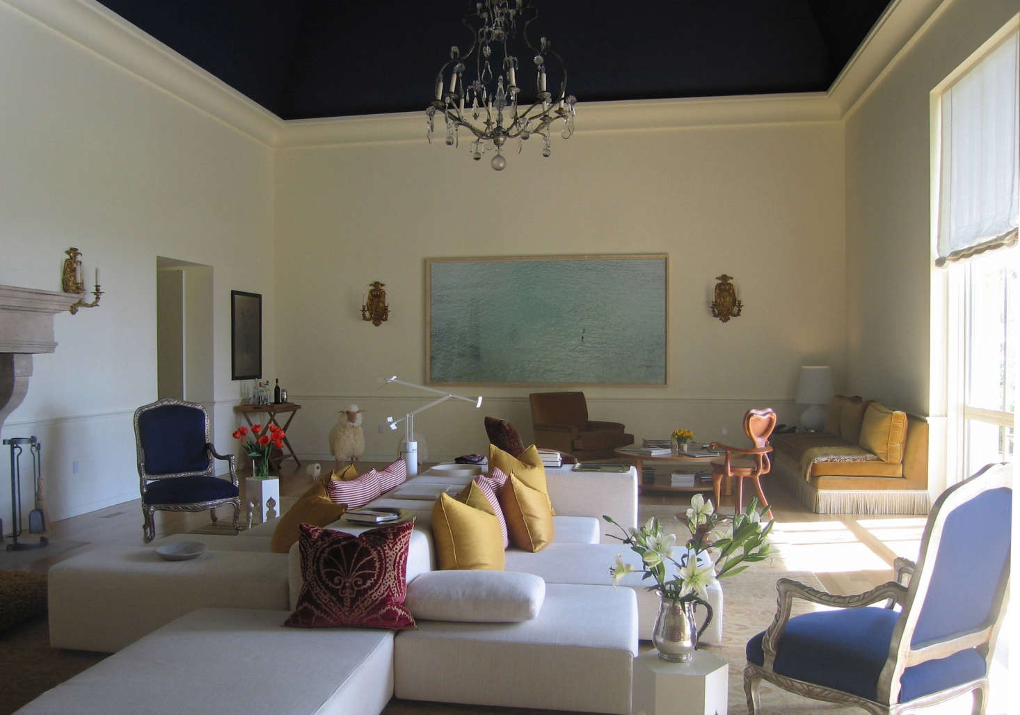 Great Room, Montecito: This enormous room is broken up into various seating areas for different sorts of groupings. The modern Italian sectional roots the room at the center, with French Bergeres and other traditional elements giving depth to the design. Photo: Laura Clayton Baker
