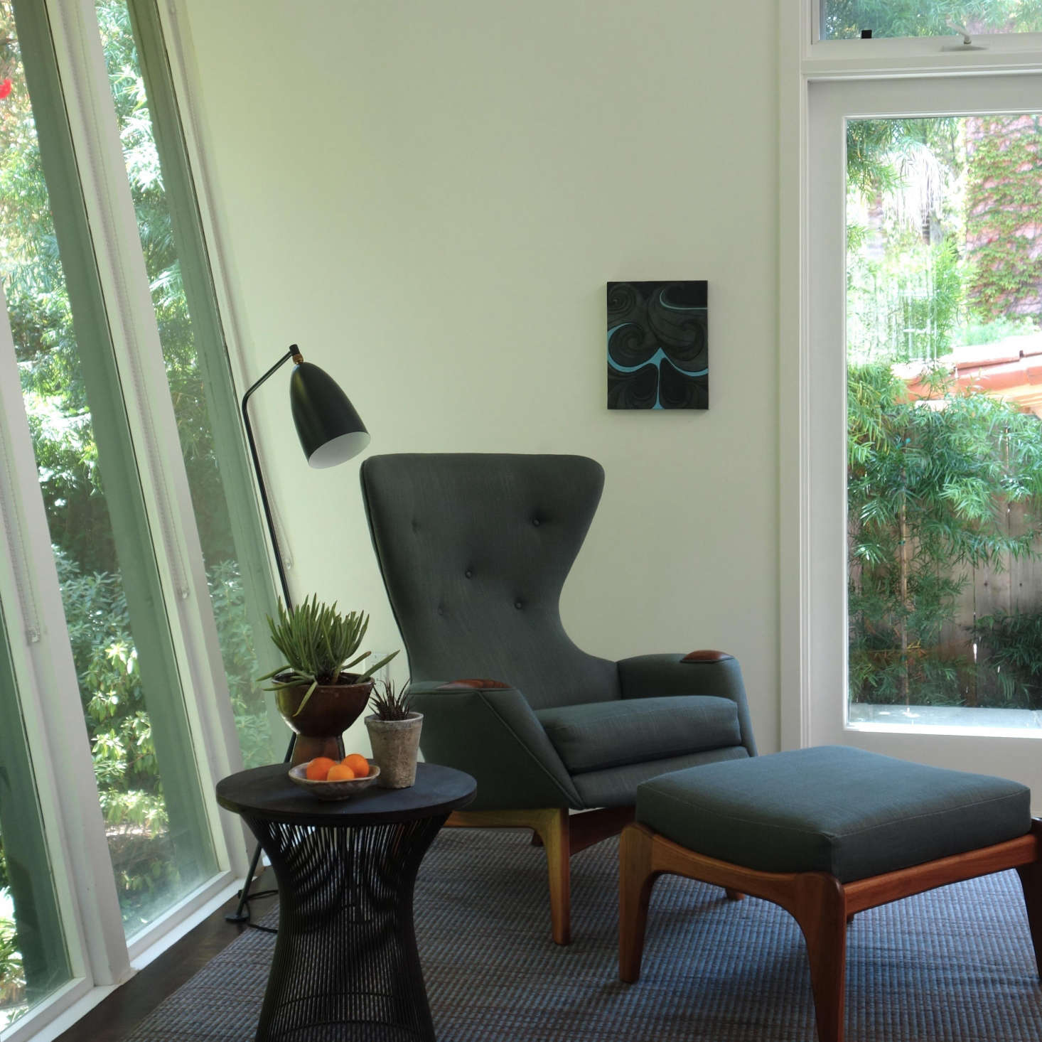 Living Room, Santa Monica: Placing this sculptural Adrian Pearsall chair and ottoman in the corner helps draw attention to the distinctive angled windows facing the front of this 60s home. An Elizabeth Eakins Tatami rug creates a subtle pattern on the floor. Photo: Laura Clayton Baker