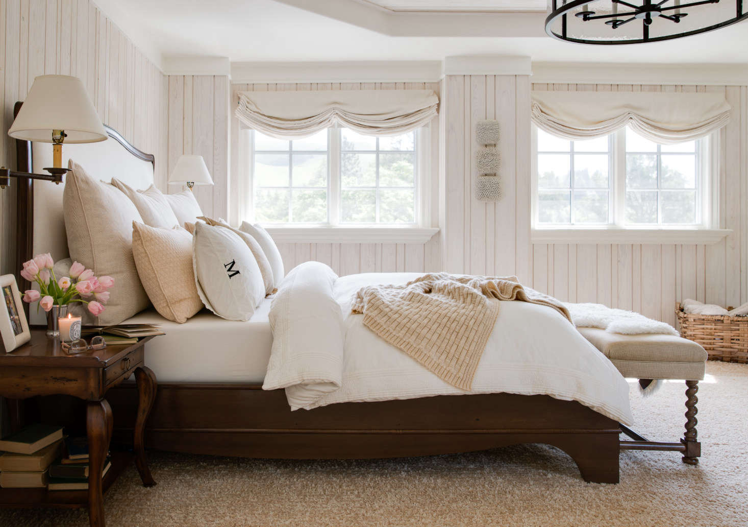 A sophisticated guest bedroom in shades of whites and neutrals that is cozy and timeless. Photography by Thomas Kuoh
