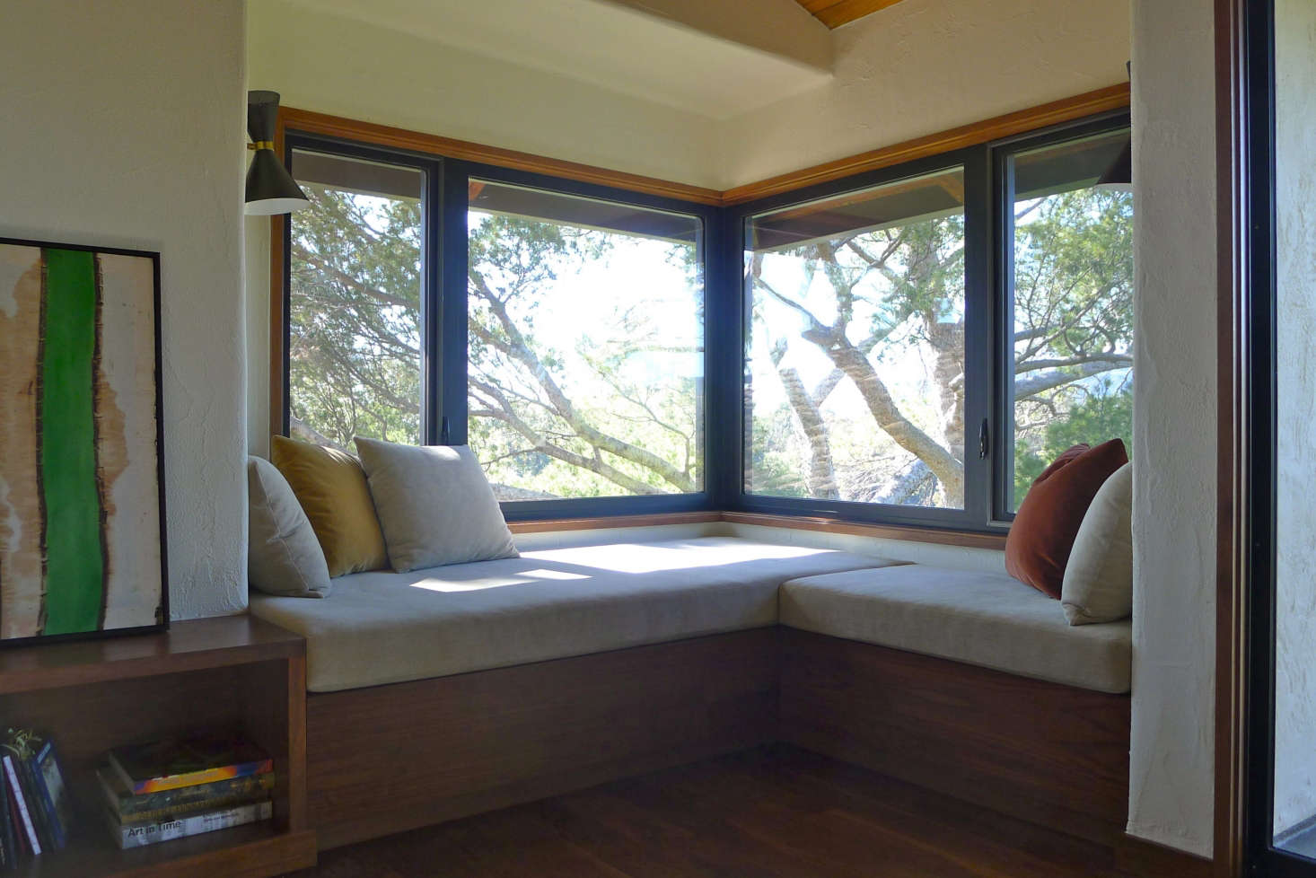 Master Bedroom Suite, Pacific Palisades: This deep window seat was designed to make the most of the spectacular view. The bookshelves on the left aresized for a large collection of art books, and the surface is made for leaning artwork and as a pedestal for sculpture. Photo: Laura Clayton Baker