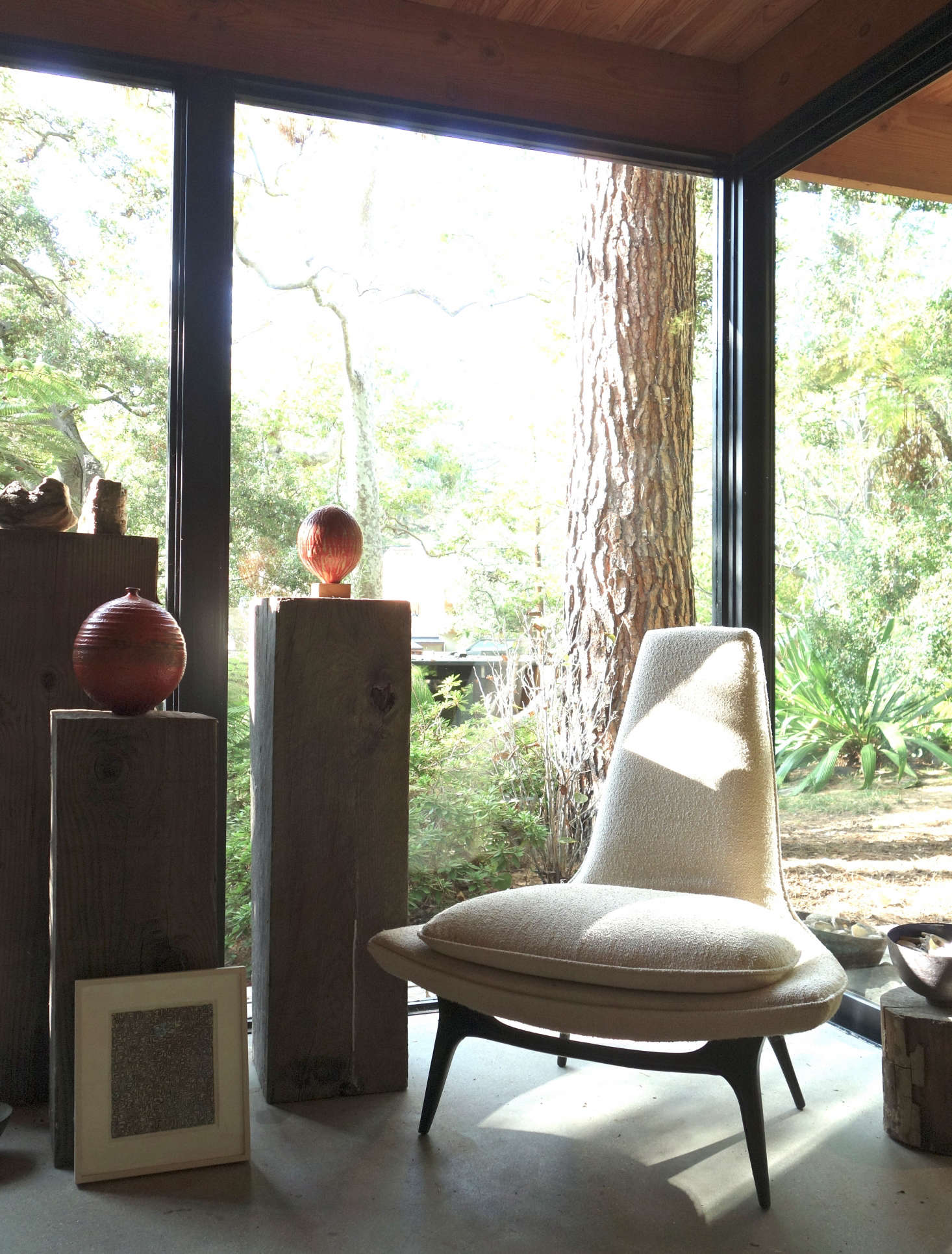 Studio, Santa Monica: A vintage Karpen chair, oak pedestals, and ceramics fill the corner. Photo: Laura Clayton Baker