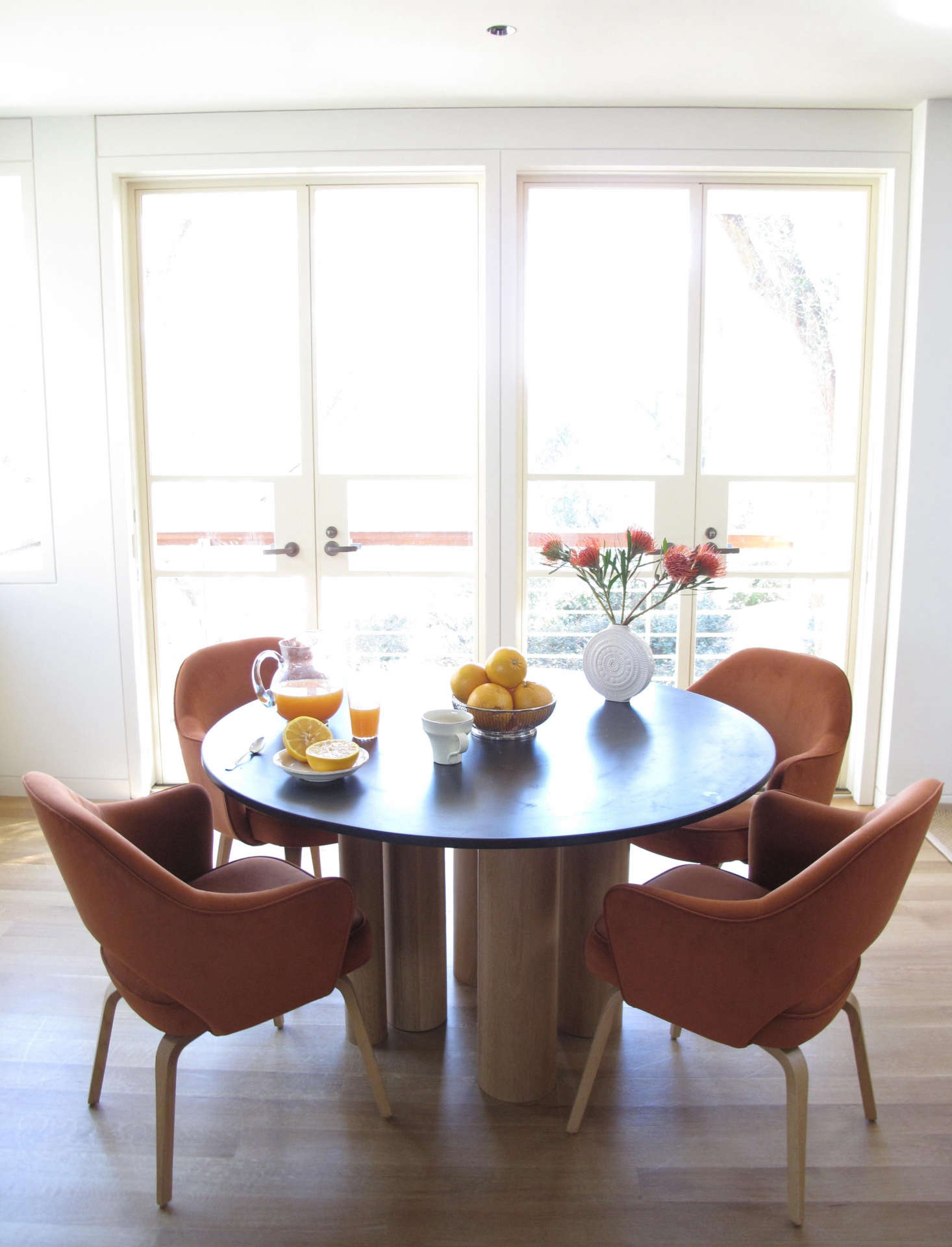 Breakfast Room, Montecito: Michael Paladino and I worked on this custom tablePseemingly random oak columns supporting a slate top. The Saarinen chairs are a favorite of mine, and hold up well to small children upholstered here in ultra-suede. Photo: Laura Clayton Baker