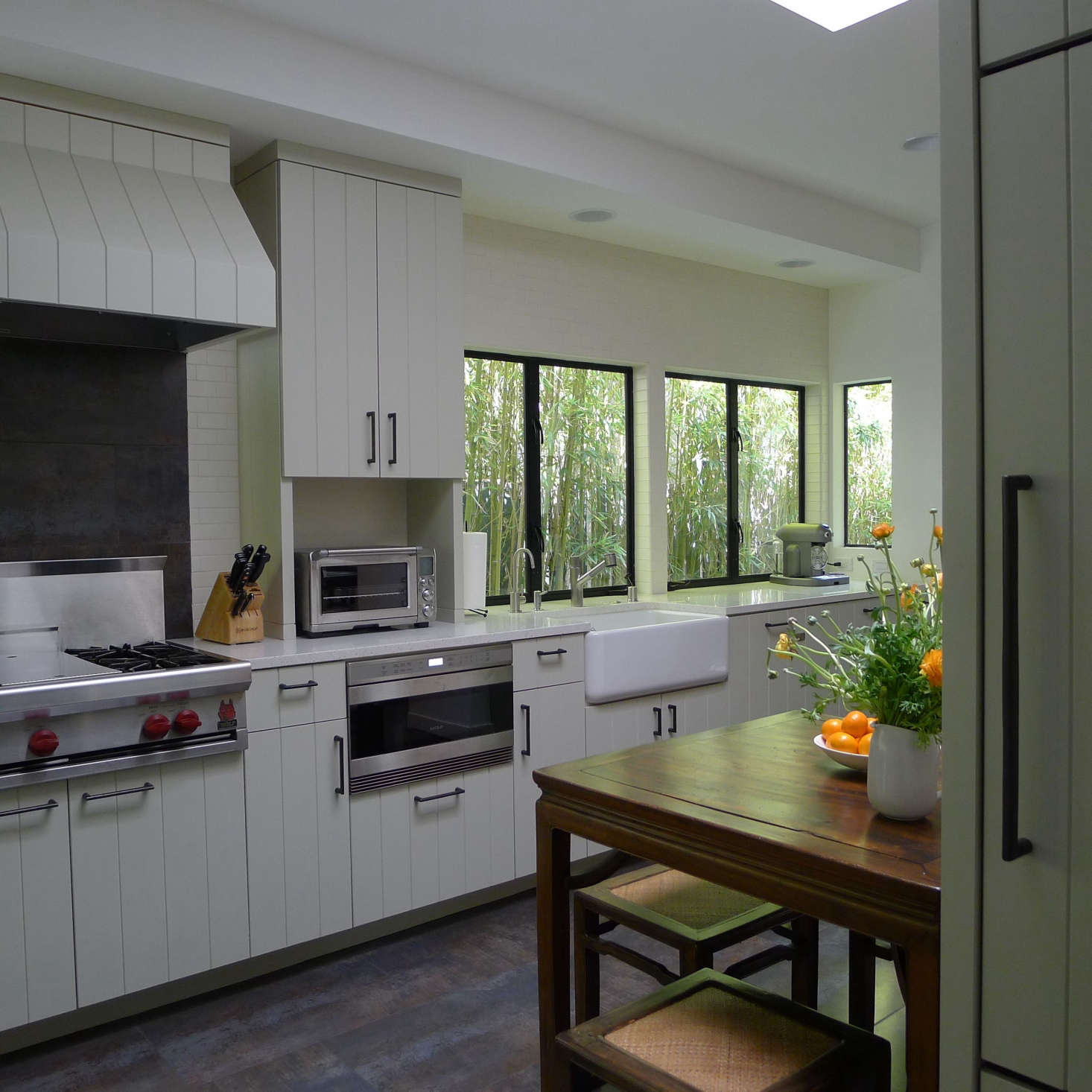Kitchen, Santa Monica: The linear detail of the cabinetry unifies this kitchen. The windows were enlarged, so that the bottom of the windows came down to the counter height. The client&#8