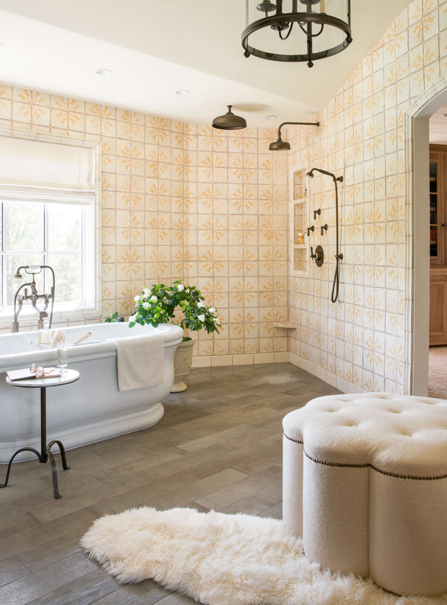 Open shower feature in master bath with yellow patterned tile on the walls. Thomas Kuoh Photography.