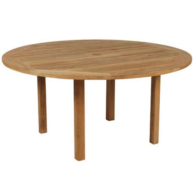 10 easy pieces round wood outdoor dining tables gardenista for Circular wooden table