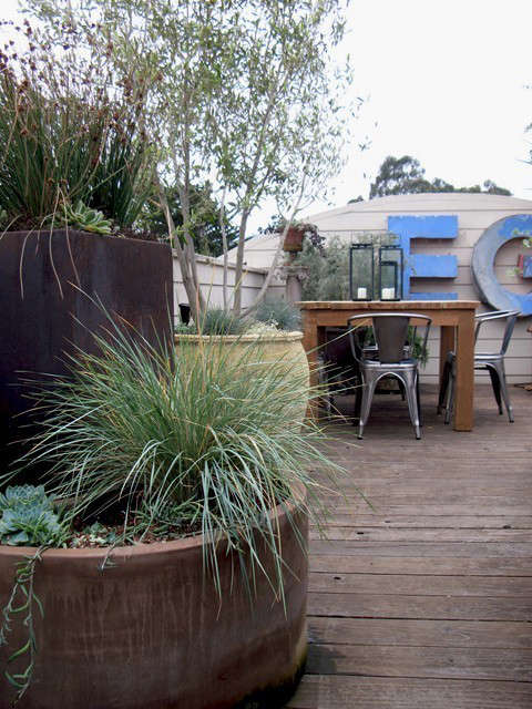 Letters and Grasses and Tigers, Oh My!: This rooftop garden increases the client&#8\2\17;s livable space \2 fold. We were able to incorporate seating, dining and cooking areas but overall it just feels like a getaway much farther away than just pstairs&#8\230;. Photo: Beth Mullins