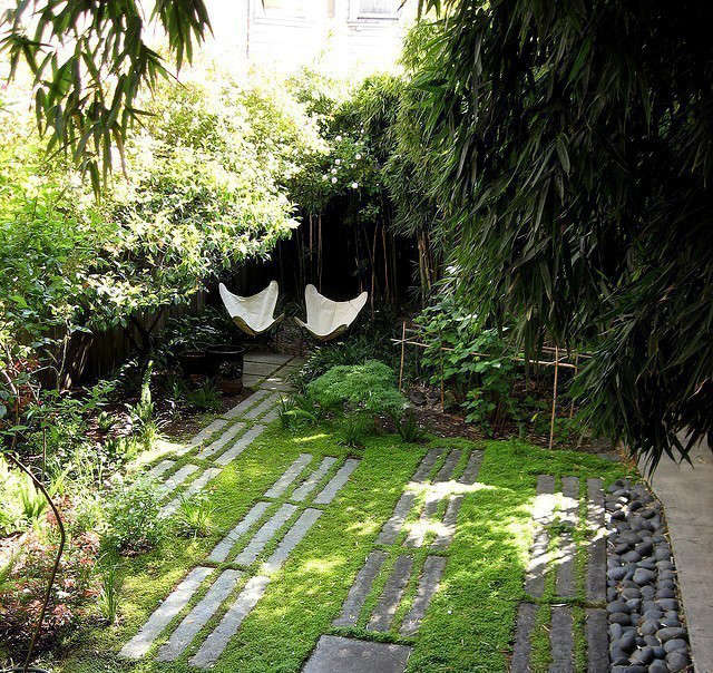 Memorial Garden: This design of this garden creates a protected place to sit and be. Granite curbing makes an informal pathway or patio with the emphasis being on green and texture. The client was inspired by the Aids Memorial Garden in Golden Gate park so we included lines and elements reminiscing of that. Photo: Beth Mullins