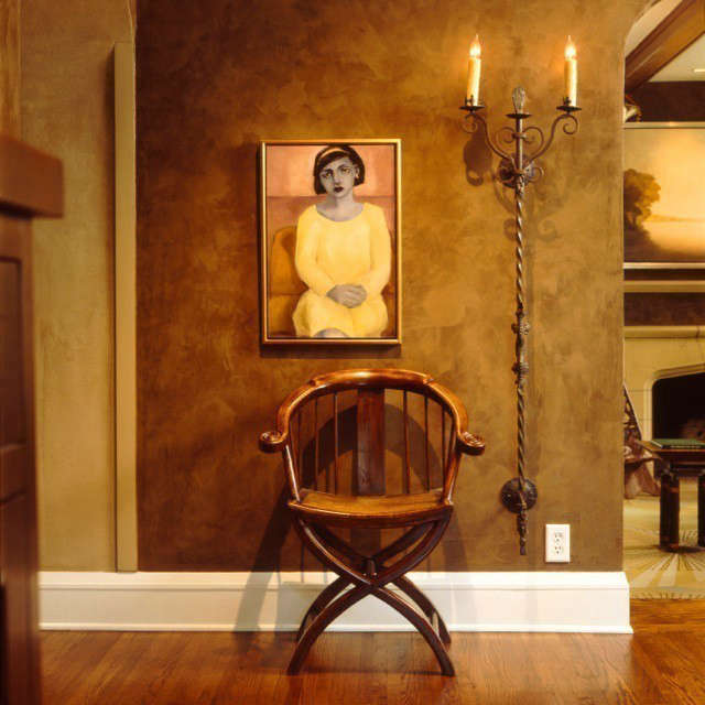 Updated Tudor Modern Foyer &#8\2\1\1; The placement of chair, tall wall sconce and contemporary portrait creates pleasing vignette