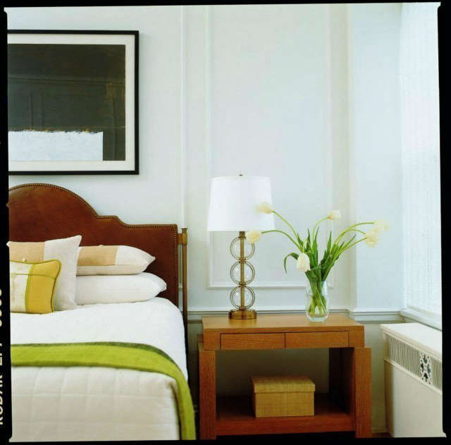Minneapolis Apartment Modern Bedroom &#8\2\1\1; The Andrew Flesher designed custom metal and leather bed adds a masculine touch to this uptown bedroom