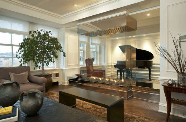 Uptown Apartment Modern Living Room &#8\2\1\1; The enclosed clear glass fireplace creates a dramatic view of the music room beyond.