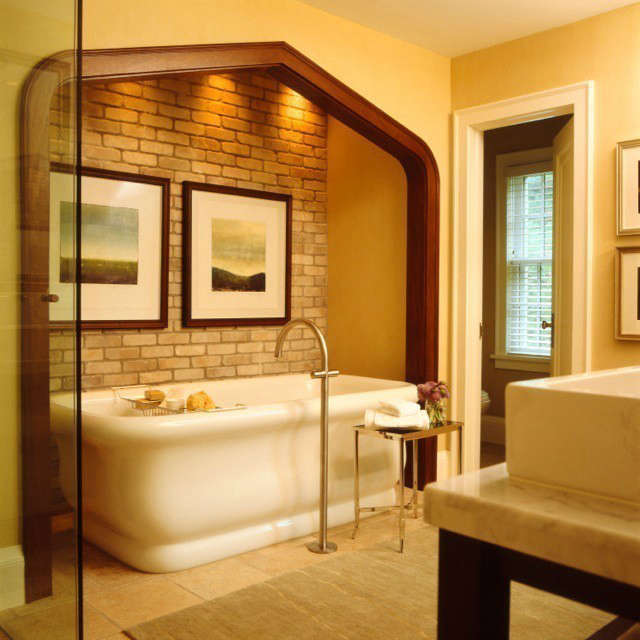 Updated Tudor Modern Master Bath &#8\2\1\1; The placement of this deep curvaceous bathtub in an alcove creates a spa like experience