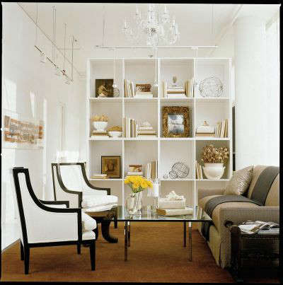 White Loft Traditional Study &#8\2\1\1; A tall custom book case defines this cozy space for a tete-a-tete.