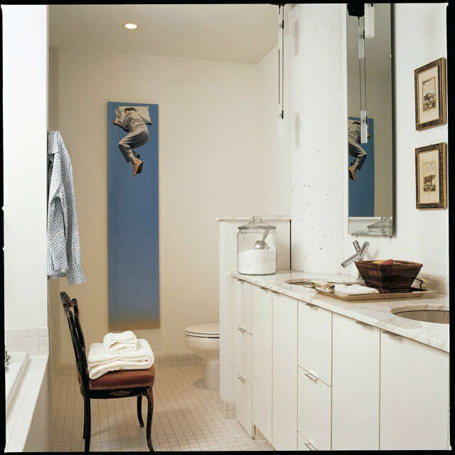 White Loft Master Bath &#8\2\1\1; The whimsical vertical painting creates a focal point in this all white bathroom.