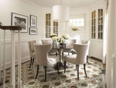 Cape Cod Traditional Dining Room &#8\2\1\1; The floor of this Cape Cod style dining room, with built in corner cabinets, features a custom painted design in place of a rug for a traditional yet modern feel.