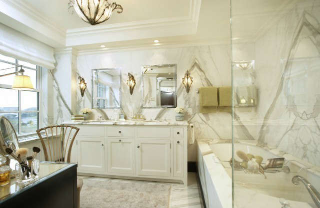 Uptown Apartment Traditional Master Bathroom &#8\2\1\1; The walls and floor of this beautiful bathroom are clad in slabs of Calcutta Gold marble.