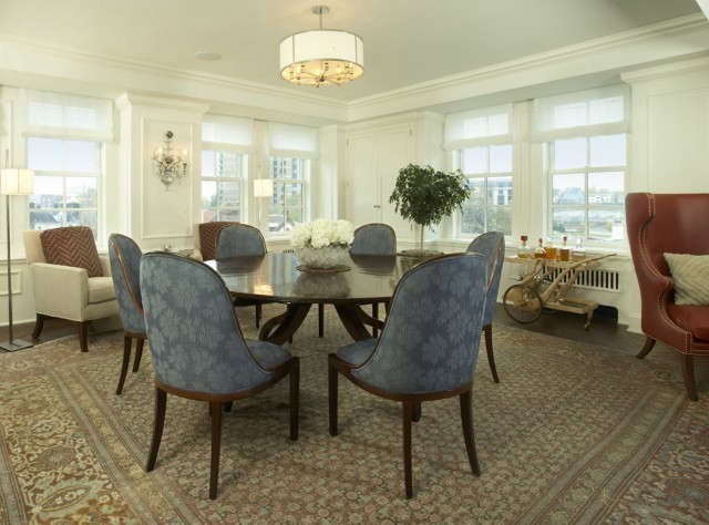 Uptown Apartment Traditional Dining Room &#8\2\1\1; A round table that expands to seat ten makes great use of this square shaped dining room.