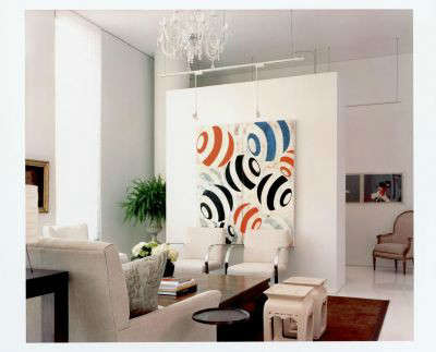 White Loft Modern Living Room: The &#8\2\20;pop&#8\2\2\1; of colorful art defines and enlivens the living area in an all white loft.
