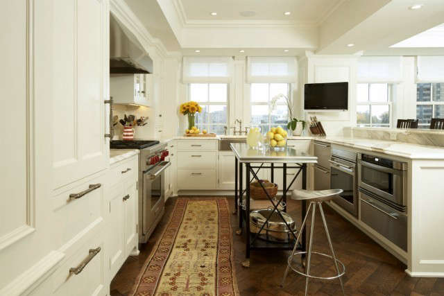 Uptown Apartment Traditional Kitchen &#8\2\1\1; The cook in this kitchen enjoys the view of the dining room, and of the city beyond.