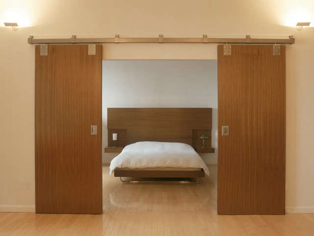 barn doors reveal a bed for the Barlow-Lawson Apartment: click here for more information on the Barlow Lawson Apartment Photo: Lukas Hepler