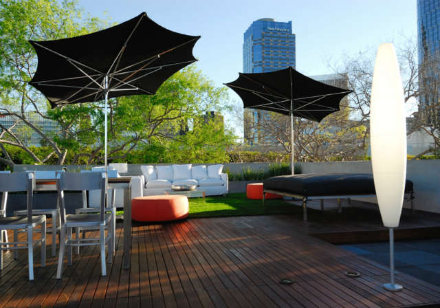 Century City Rooftop: Inspiring cityscapeContemporary outdoor furnishings and sun shades create entertainment areas with dramatic rooftop views of the city. Photo: Russ Cletta
