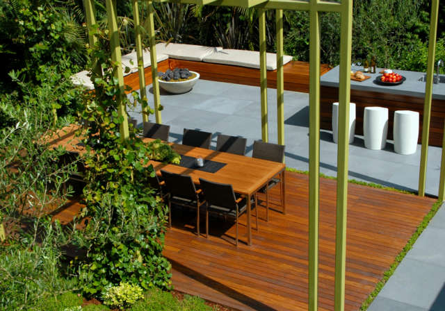 Studio City: Outdoor dining roomEcologically sound ipe decking and honed bluestone pavers sit flush on the ground plane beneath the dining trellis. Photo: Russ Cletta