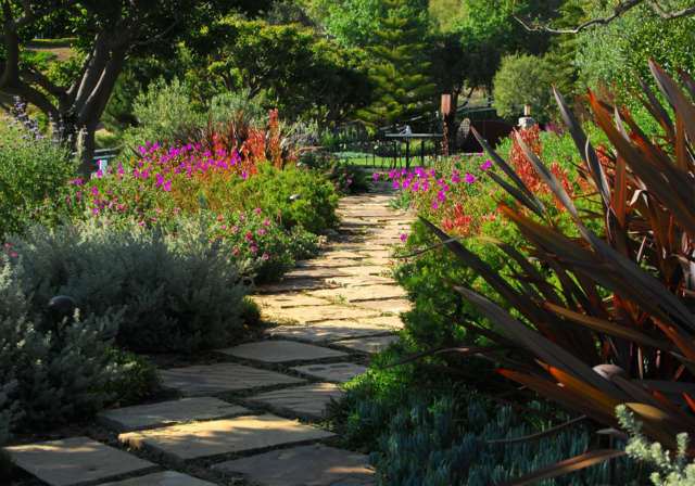 Malibu Residence: Stone footpathNatural stepping stones meander through brilliant blooms and drought-resistant perennials. Photo: Russ Cletta