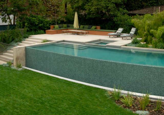 Sullivan Canyon Residence: Simple EleganceThe raised pool and spa patio, featuring built-in patio seating, are as simple as they are luxurious. Photo: Russ Cletta