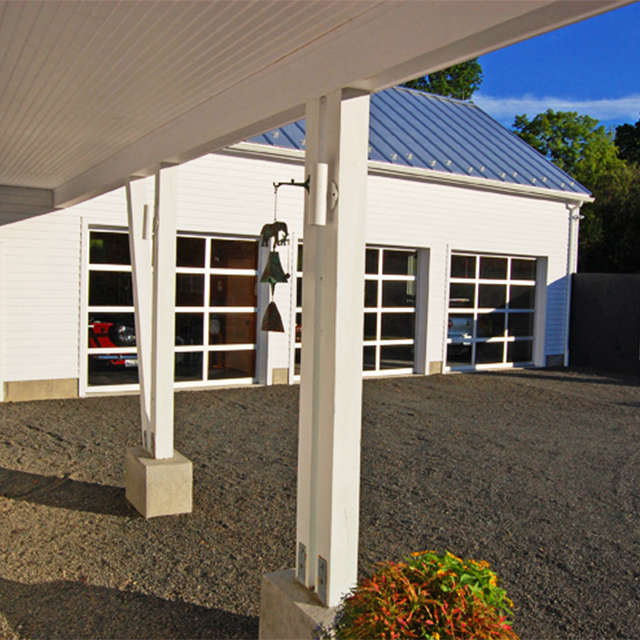 Painter Hill Residence, Roxbury, CT: view of garage from front door Photo: Andra Georges