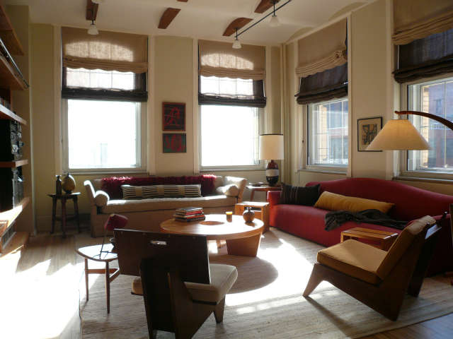 Tribeca Loft Living Room &#8\2\1\1; We mixed new pieces with old, the square back chair is designed by Frank Lloyd Wright, The table is Harvey Probber. The arc lamp is Italian Mid Century. The shades were custom made using burlap linen over horse hair.