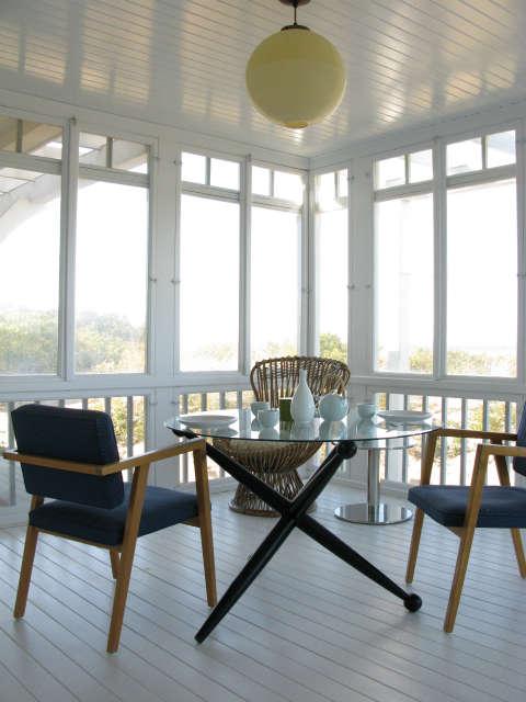 Martha&#8\2\17;s Vineyard Cottage &#8\2\1\1; Sunporch. Franco Albini chairs, mid century Italian table.