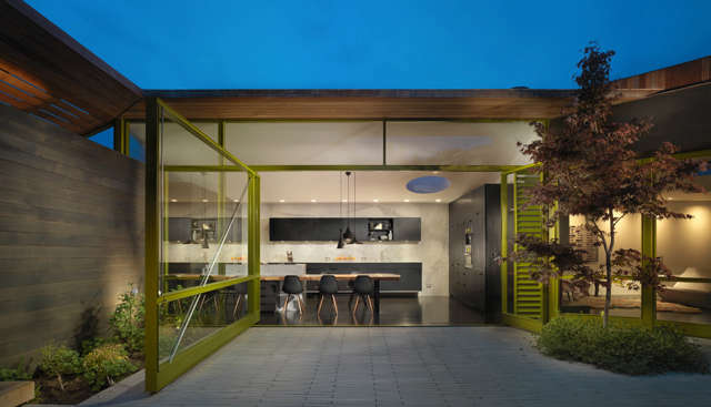 Mill Valley courtyard: This home is organized around a rear courtyard. A large pivoting door creates a truly indoor/outdoor home. Photo: Rien van Rijthoven