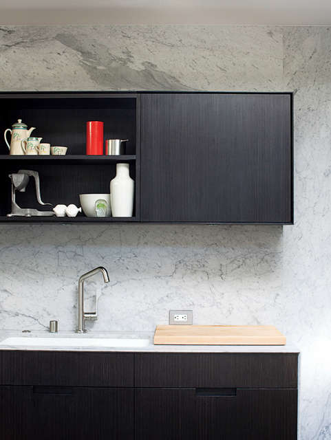 Mill Valley kitchen detail: A marble slab backsplash highlights the ebonized cabinetry. Photo: Rien van Rijthoven