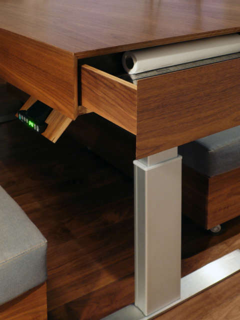 Transformer Loft &#8\2\1\1; table: At the touch of a button the table converts from dining to a counter or a workdesk, complete with secret compartments inside. Click here for more information. Photo: Robert Garneau