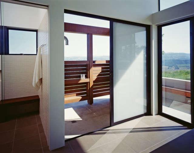 Ridge House: Indoor and outdoor showers. Photo: Sharon Risedorph
