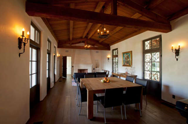 La Mesa Dining Room &#8\2\1\1; Dining room with trussed ceiling system, terminating in a small living soace with fireplace.