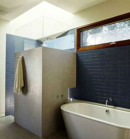 Winebaum Residence &#8\2\1\1; Blue tile walls with natural lighting from skylight over shower. Clerestory windows over tub provide more light to bathroom.