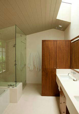 La Mesa Residence &#8\2\1\1; Bathroom with double sinks and natural lighting emitting through skylight over sink.