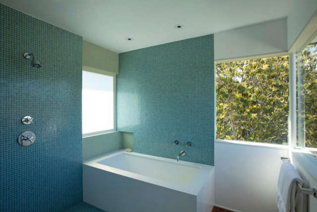 Isaacson Residence &#8\2\1\1; Tile walls surrounding a shower and tub bathroom space.
