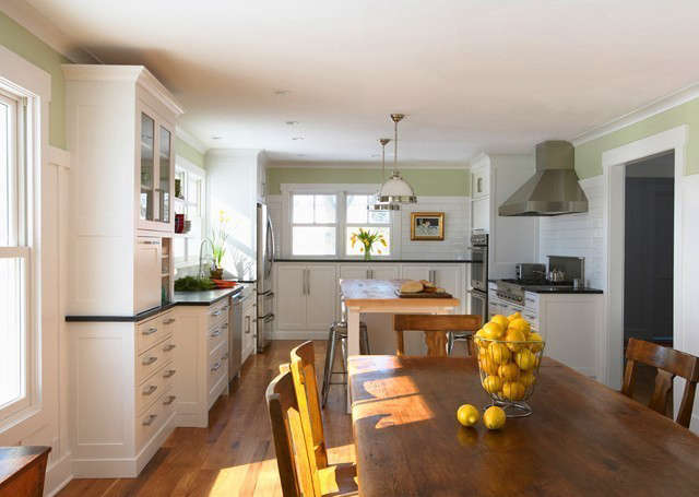 Hastings Farmhouse: This family farmhouse received a major update. White painted cabinets replaced the dark stained wood ones and brighten up the space. Photo: Susan Gilmore