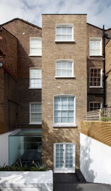 House, Notting Hill London: A four storey family home.The project required excavation of the basement and demolition and re-building of the four-storey rear extension. The interior of house has been completely remodelled.