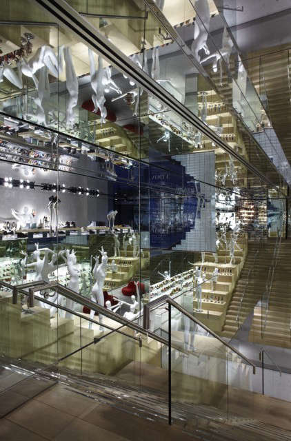 Kurt Geiger, Covent Garden Flagship Store: The newly completed Flagship store in Covent Garden is a maze of mirrors with an enormous staircase.The mirrors lining the perimeter, with their infinite reflections, provide the spectacle that animates the simple geometry of the design.
