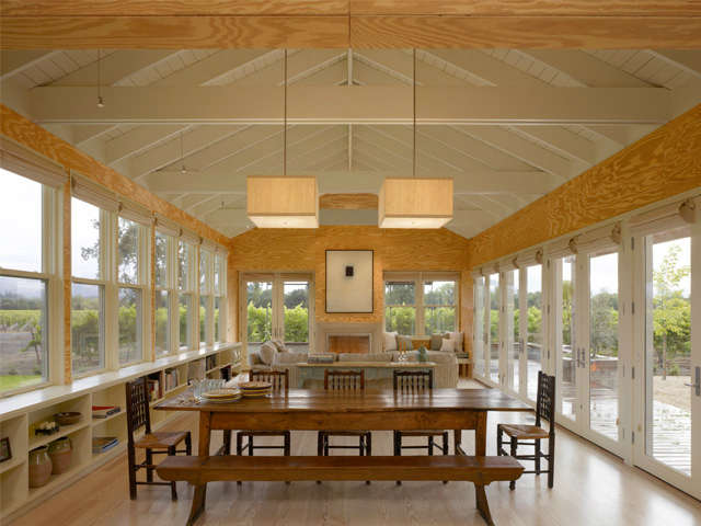 Healdsburg Residence: Dining within the vineyard. Plywood sourced from owners plywood factory. Photo: Cesar Rubio
