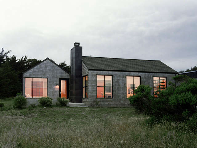 Sea Ranch Residence: A copper clad chimney mass connects two simple volumes at this Sea Ranch residence. Photo: JD Peterson