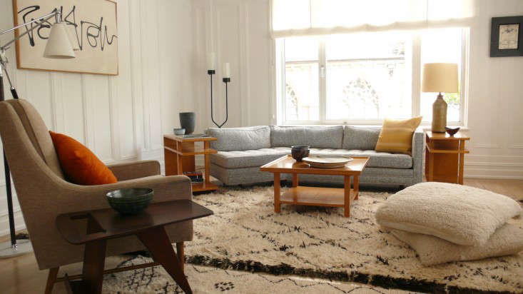 Ceilings And Period Wainscoting But The Apartment Feels Far More Comfortable Designers Filled Room With Cozy Furniture Including Thick Rugs