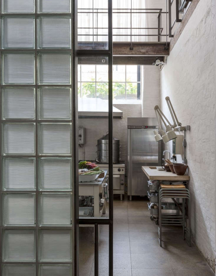 Alastair-Hendy-London-kitchen-industrial-lights-via-Remodelista