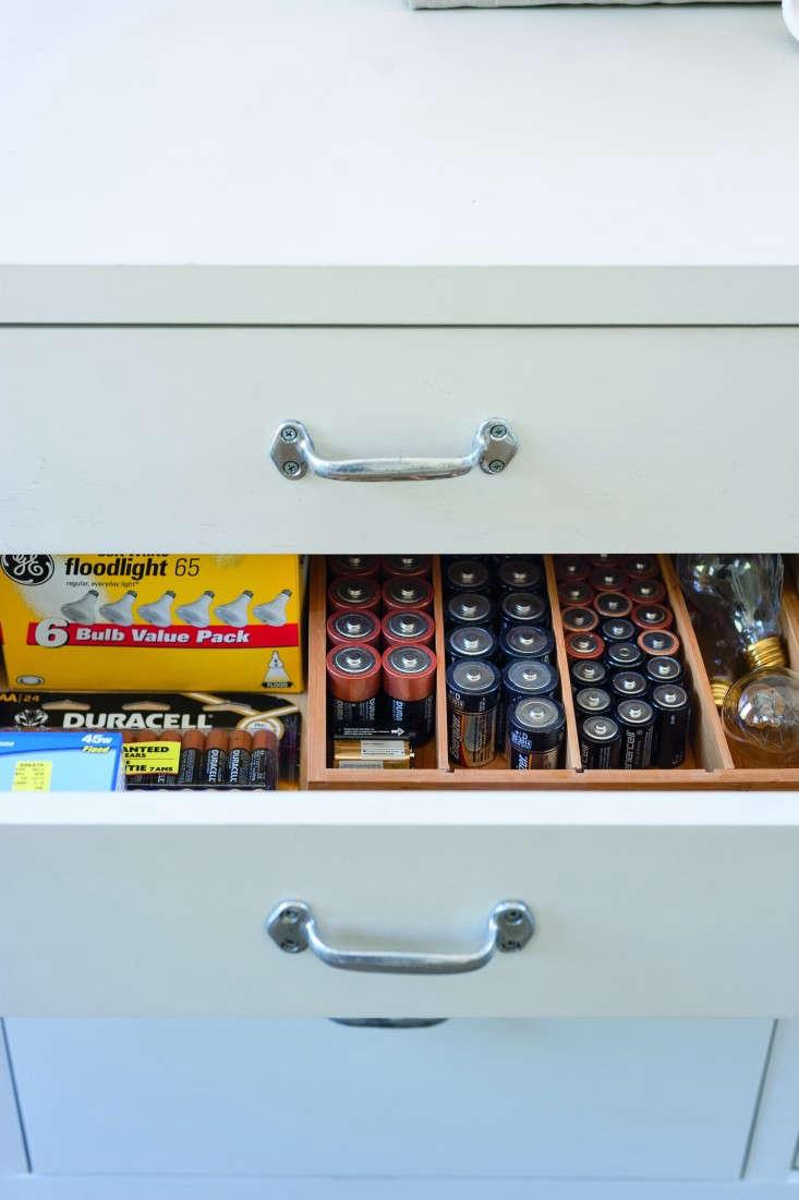 Amanda-Pays-Corbin-Bernsen-laundry-room-battery-drawer-Remodelista