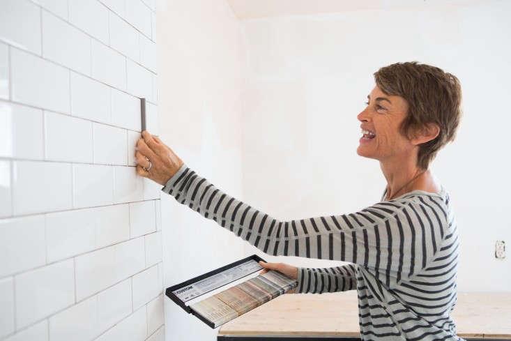 Amanda-Pays-picking-tile-grout-Laure-Joliet-Remodelist