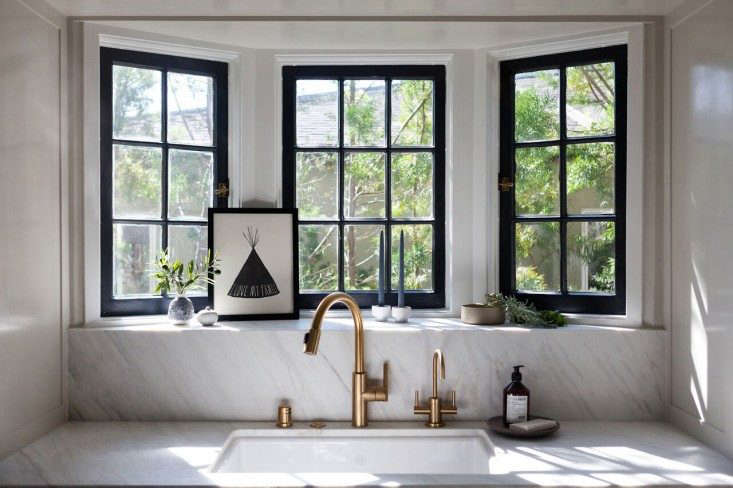 Calacatta marble frames the sink and windows in interior designer Amy Sklar's LA kitchen. See the rest atKitchen of the Week: Practicality in White Marble.