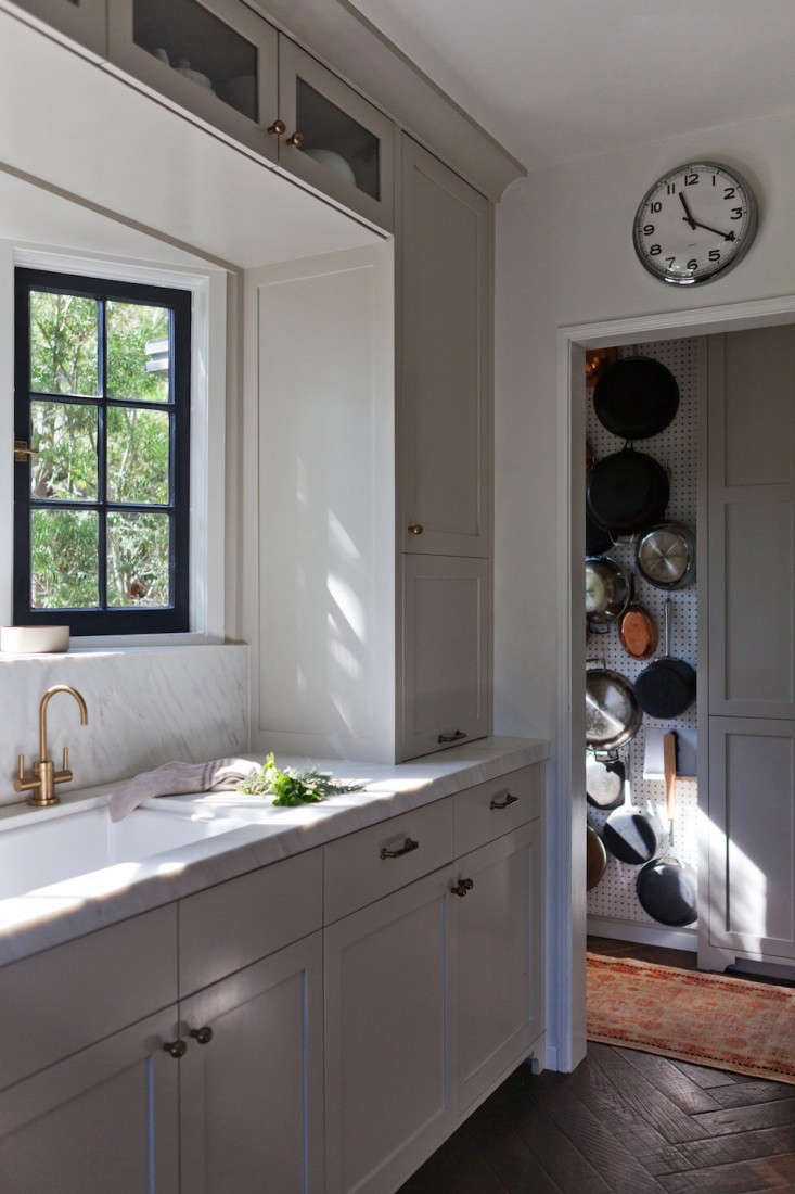 A well-proportioned countertop and base cabinets. Note also: the cabinetry with doors hinged on top that stash small appliances. Photograph fromKitchen of the Week: Practicality in White Marble.