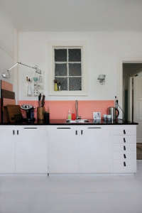 Anne Mette Skodbor, Copenhagen home, painted coral backsplash in kitchen  | Remodelista